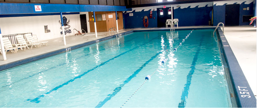 located inside a longstanding fitness center within the rochelle community the olympic size swimming pool is the largest and only indoor facility in the